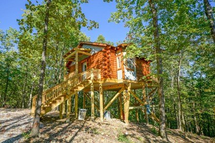 FOR AN ELEVATING WEEKEND: Hot Springs Treehouses near Hot Springs National Park offer hot tubs on high, plus a creekside house.