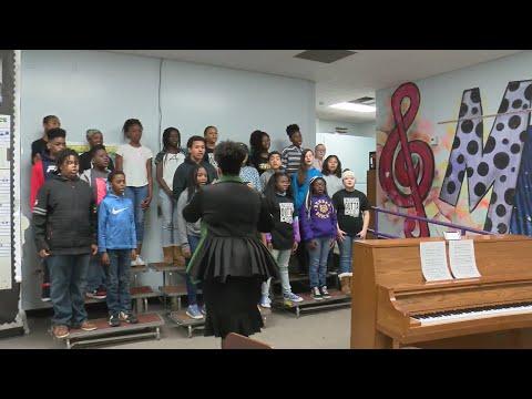 VIDEO: Dunbar Magnet Middle School Choir spreads joy in the community