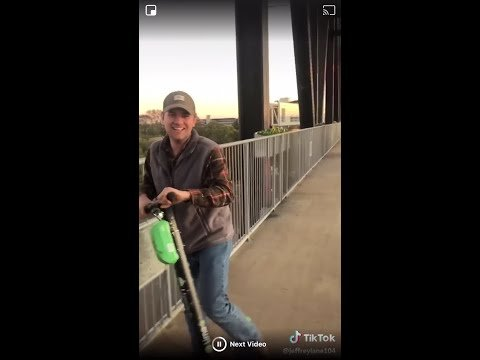 VIDEO: Man throws lime scooter into river