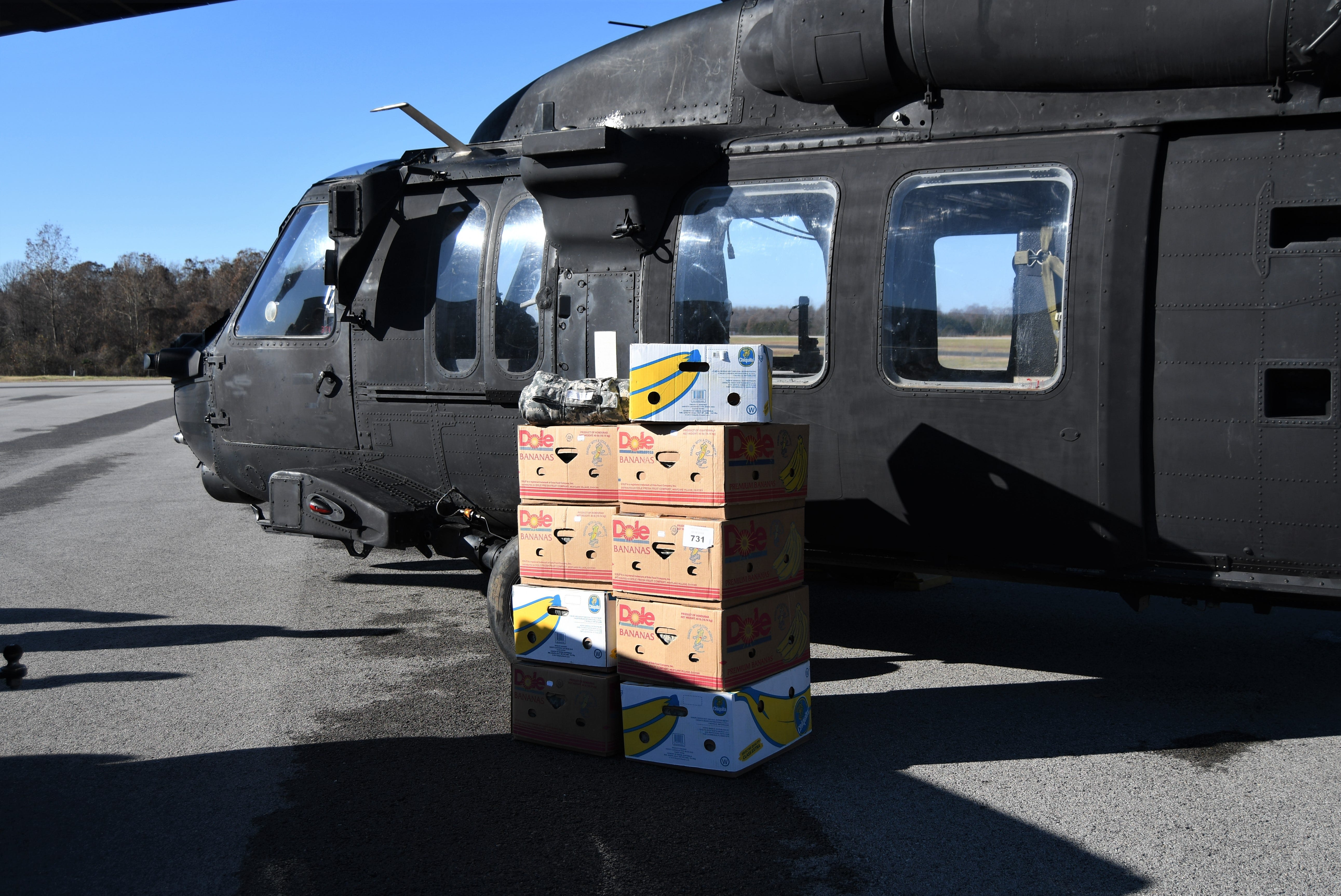 Nine cardboard boxes holding Sandra Kiphuth's camouflaged quilts sit in front of the Black Hawk helicopter dispatched to pick up them up on Nov. 25.