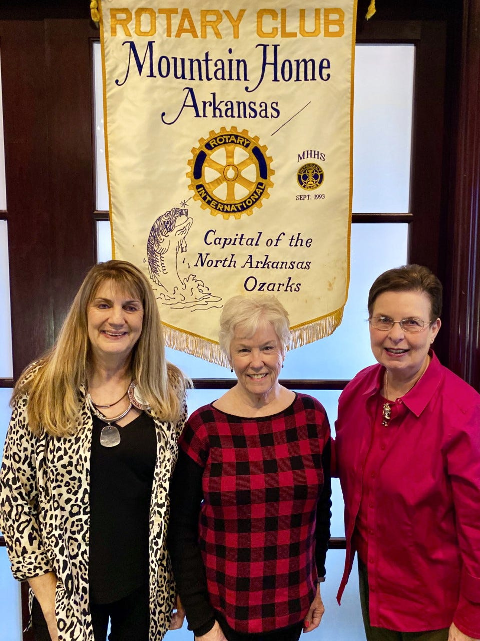 "The guest speakers on Thursday, Dec. 5 at the Mountain Home Rotary Club were Virginia Cornett and Sandy Priebe with the Arkansas Quilt Trail. Cornett spoke about the different quilt patterns that people may choose from or design their own that, after approved, are then painted in large squares on plywood and attached to barns, businesses, buildings, or fences. They hope to have ""barn quilts"" in every county in Arkansas, and are off to a good start with almost 100 currently on display in a five-county area. They gave each Rotarian a pamphlet and map that shows the patterns and addresses of the North Central Arkansas ""Quilt Trail"". Pictured above are MH Rotary President Kriss Yunker and guest speakers Virginia Cornett and Sandy Priebe."