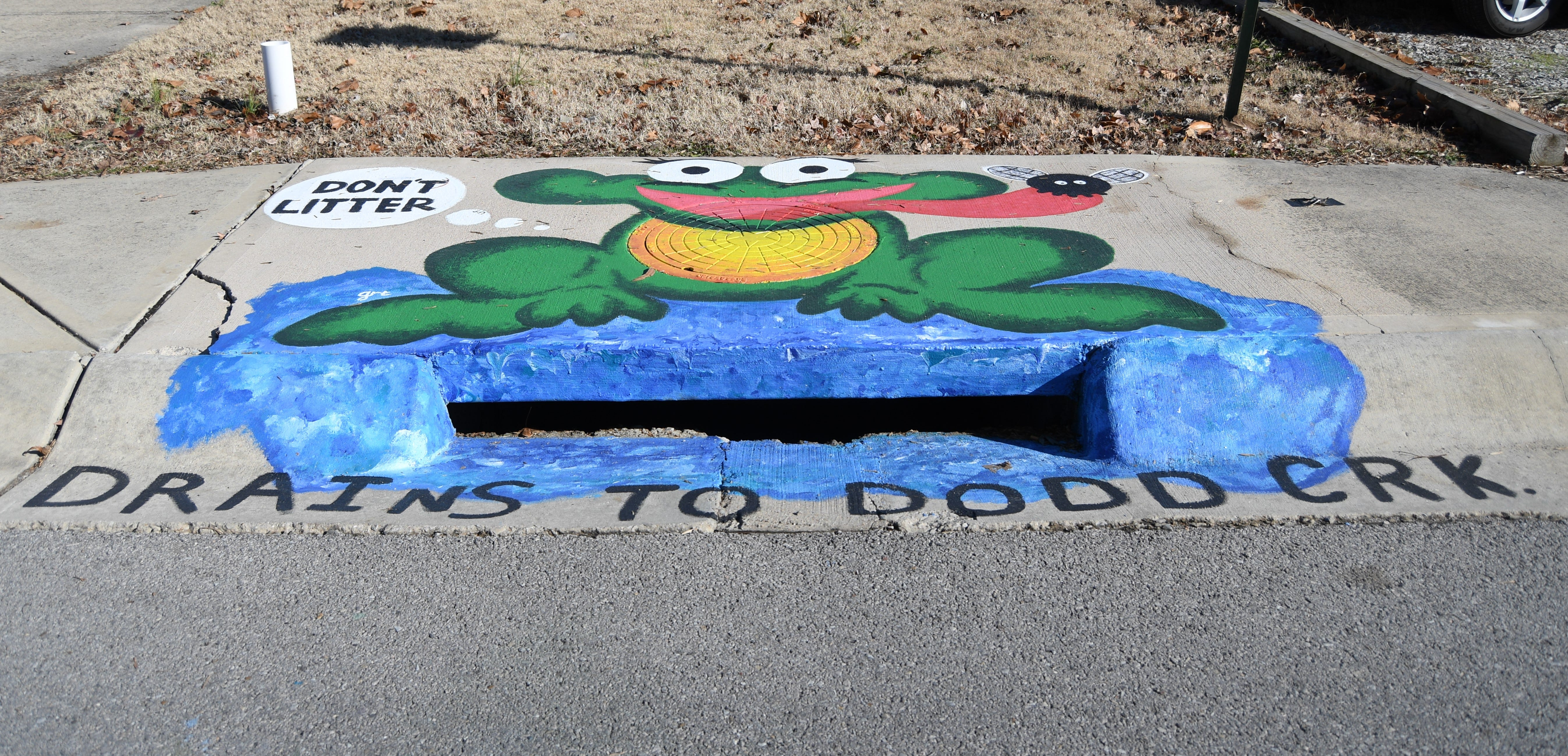 This storm drain can be found between That Print Shop and Precision Auto Repair on Bomber Boulevard. It was painted by Mountain Home High School students Gracie Todd and Lakeisha Ponce.