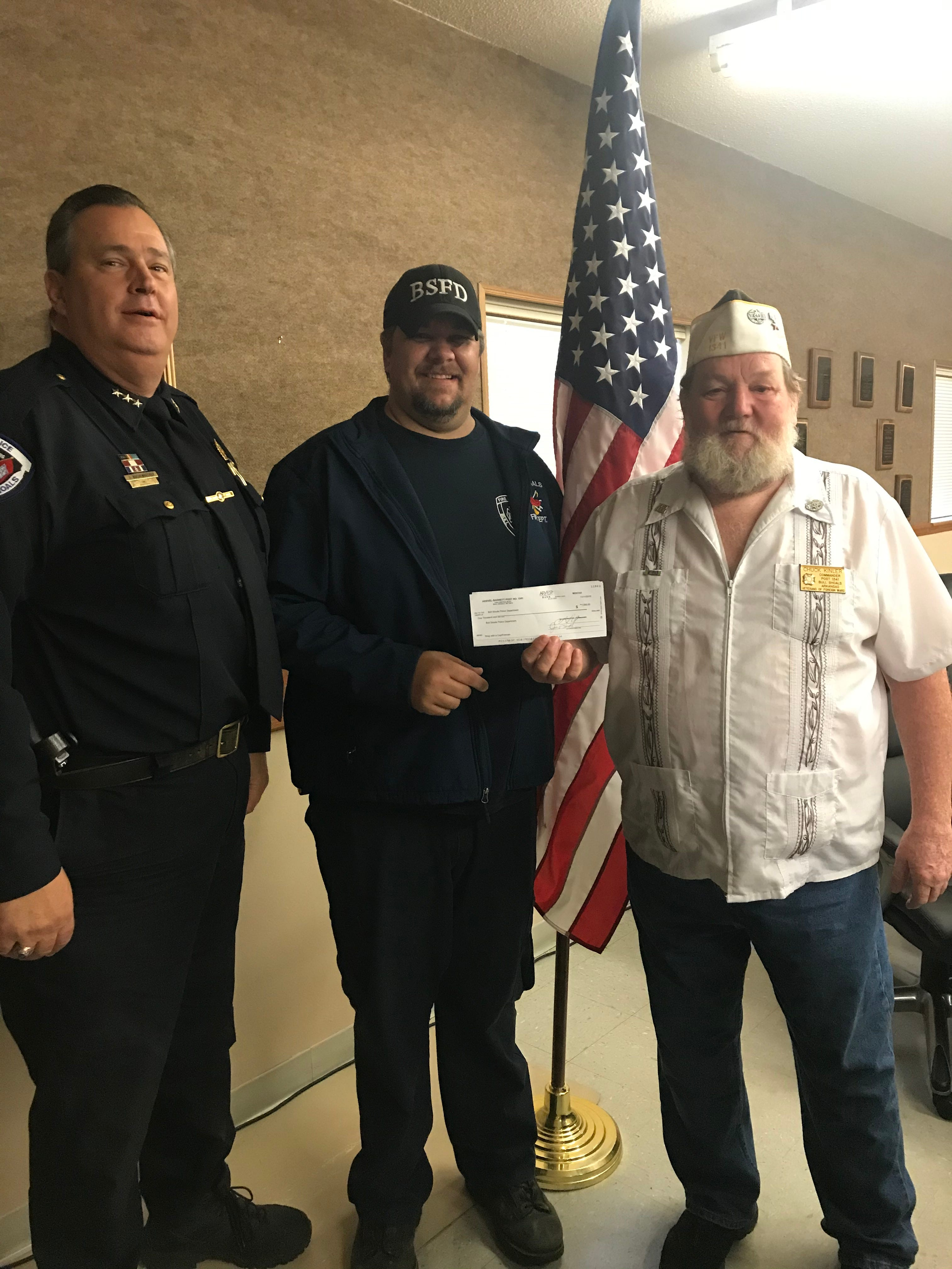 The Hoevel-Barnett VFW Post 1341 of Bull Shoals recently made a donation to support Bull Shoal's fourth annual Shop with a Cop & Fireman event. This year's event will be held on Saturday, Dec. 14 and will kickoff with a pizza luncheon at the Bull Shoals Police Station at 1:30 p.m. Shop with a Cop & Fireman has become a local staple during the holiday season in Bull Shoals and has assisted many families and children who need assistance during this time of year. The event is 100 percent funded through the generous support of local citizens, businesses and organizations like the Bull Shoals VFW. Shown in the photo are (from left to right) Bull Shoals Police Chief Jim Kuchenbecker, Bull Shoals Fire Chief Brent Mitchell and VFW Post 1341 Commander Charles Kinler.