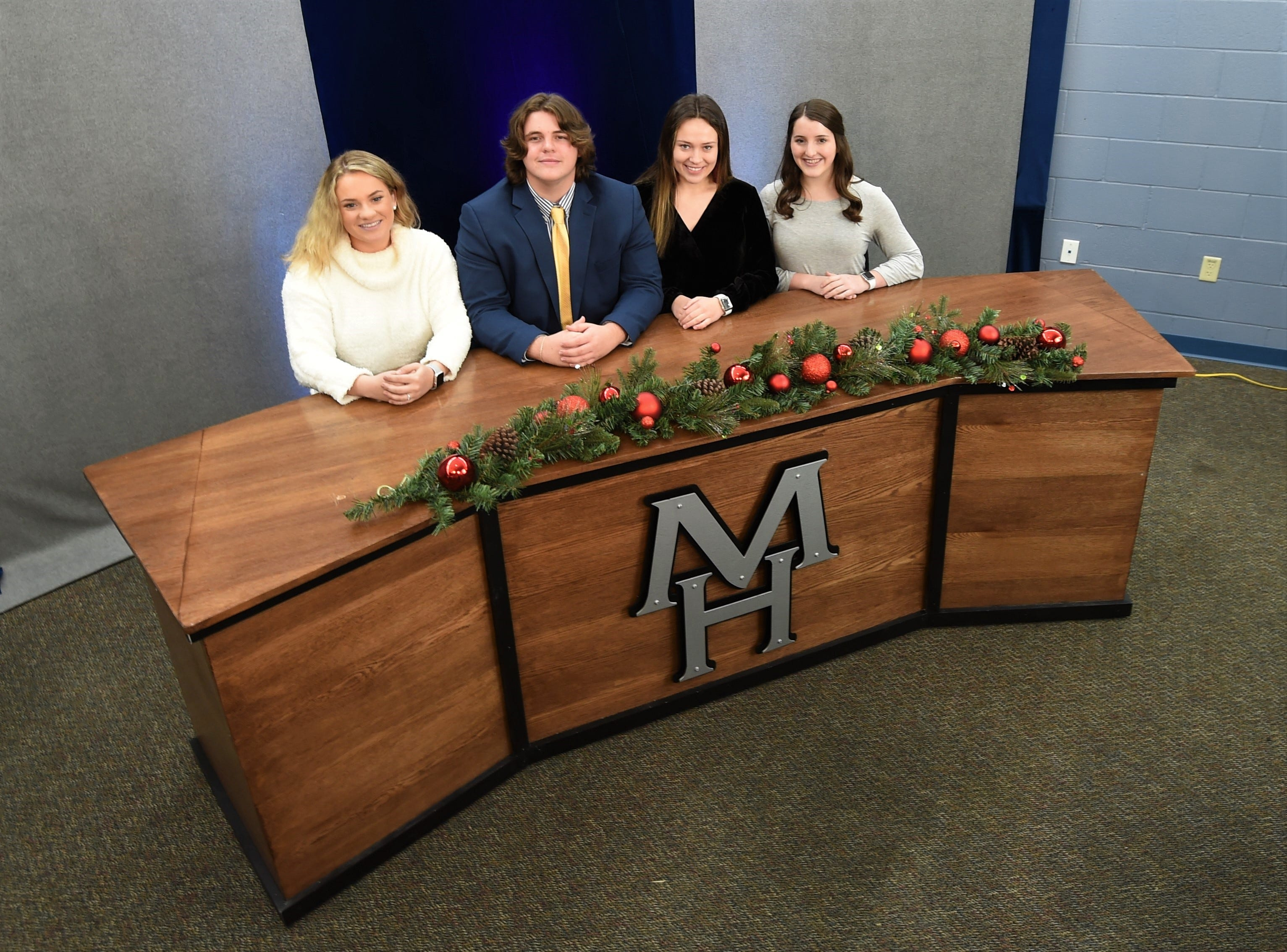 Mountain Home High School EAST students (from left) Courtney Barron, Zachary Spaulding, Sophie Quick and Lauren Dewey are four of the students involved with the Bomber News Network, a weekly TV show the debuts new episodes on Fridays.