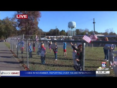 Watch: Cabot elementary students salute veterans at drive-through parade