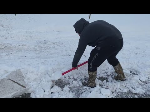 Watch: Road conditions still dangerous while crews continue to clear snow