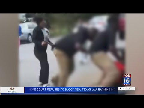 Watch: Woman accused of bringing gun onto Central High's campus, parents react